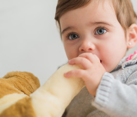Cute Baby Holding With Toy