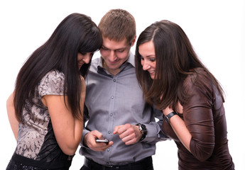 Group of surprised people looking at a cell phone