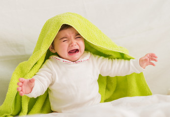 Crying Baby With Towel On The Head