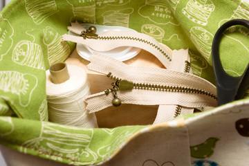 zipper, scissors and threads