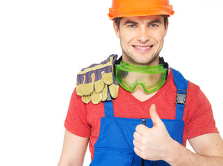 Portrait of smiling worker shows thumbs up