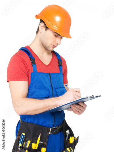 worker with tools, planning and writing the note