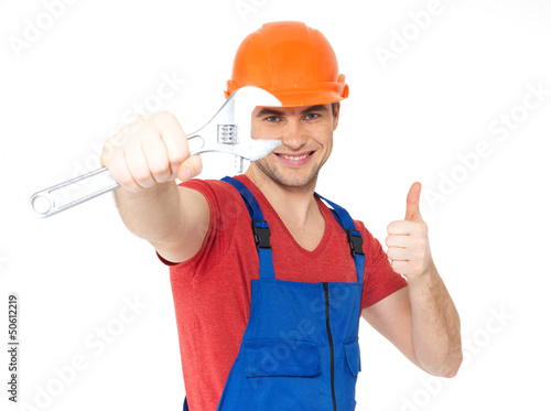 Worker with spanner showing thumbs up sign
