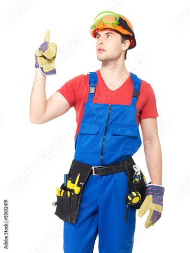 Worker with tools   points up with finher