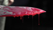 Close up of knife with blood dripping