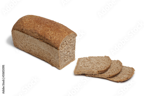 Loaf of spelt bread and slices