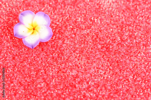 Red beads with decorative handmade flower closeup