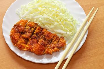 Tonkatsu. Japanese pork cutlet on white plate. Japanese food.