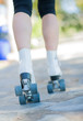Close-up Of Legs With Roller Skates