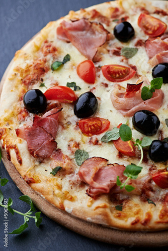 Pizza with smoked ham and olives