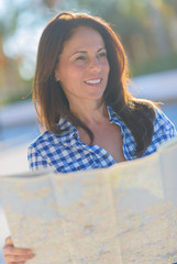 Happy Mature Woman Holding Map