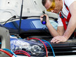 Motor mechanic checking the air handling unit of a car