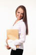 Cute young woman in business suit with yellow envelope   on whit