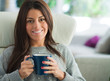 Happy Woman Holding Coffee Mug