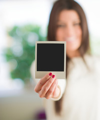 Woman Holding Blank Instant Photo