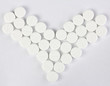 many of round pills in form of heart