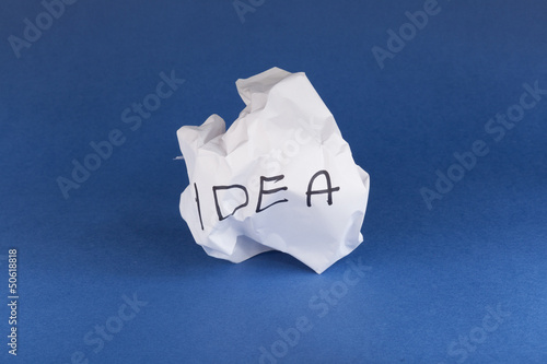 Crumpled piece of paper with idea written on it
