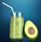 Useful fresh avocado and half avocado on dark blue background