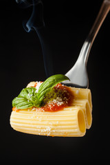 Pasta Rigatoni with ragù,parmesan and basil