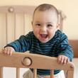 Happy baby standing in cot