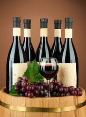 Composition of wine bottles, glasses and  grape,on wooden