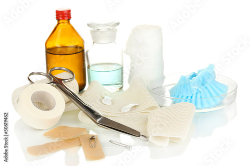First aid kit for bandaging isolated on white