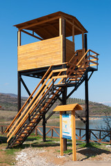 Bird watching tower and billboard at a protected wetland