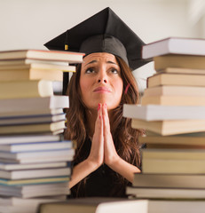 Portrait Of Graduated Woman Praying