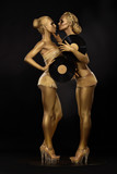 Gloden Women with Vinyl Records on Black. Gilded Bodyart
