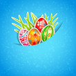 Easter blue background with egg and grass