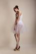 Attitude. Attractive Female standing in White Dress. Upset
