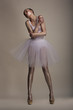Woman in White Transparent Dress Tutu in Dramatic pose. Dreams