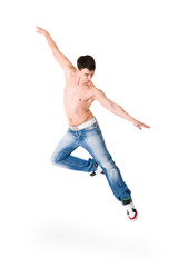 young handsome man in blue jeans jumping