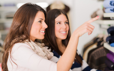 Two Women Shopping In Mall