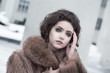 Femininity. Sophisticated Brunette in Brown Fur Coat Outdoors