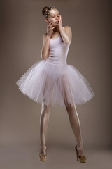 Charming Woman in White Tutu with Pearly Beads over Grey. Ballet
