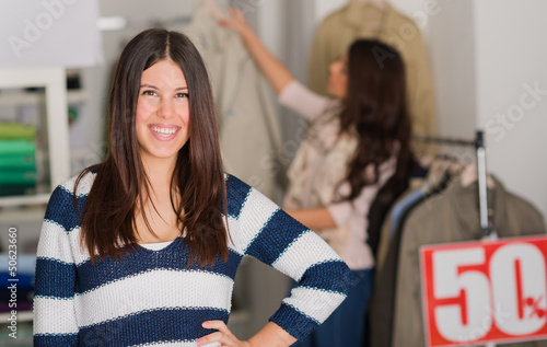 Happy Woman Standing In Shopping Mall