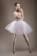 Sensuality. Elegant Styled Woman posing in White Dress. Fantasy