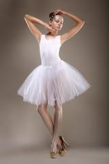 Ballet. Ballerina in White Light Tutu - Performance. Fantasy