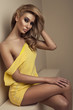 Sexy young woman in yellow dress