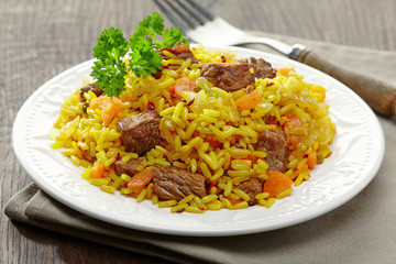 Uzbek national dish plov on plate