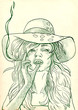 young woman in big summer hat elegantly smoking