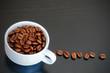 coffee cup on black wood table