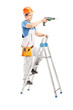 Full length portrait of a repairman with a drilling machine on a
