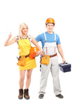 Full length portrait of a male and female construction workers w