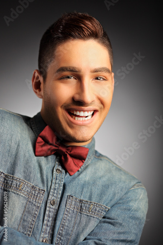 A portrait of a young smiling male
