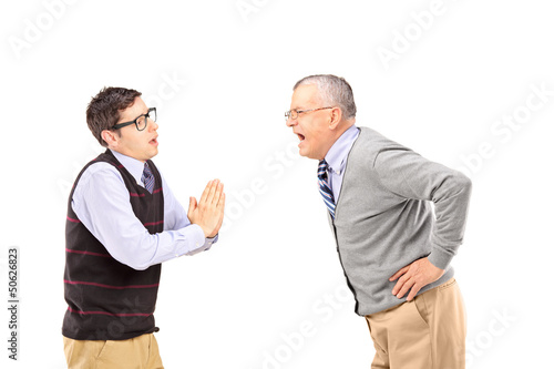 Mature man shouting at a man who is begging