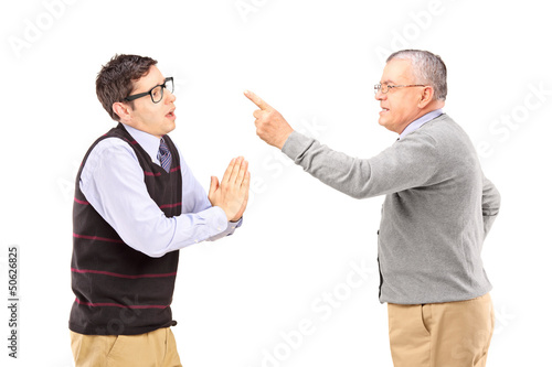 Young man begging an older angry man