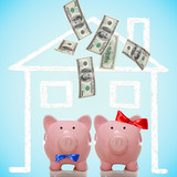 Piggy bank couple buying their dream home