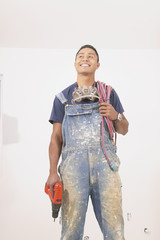 Man in overalls with power tools